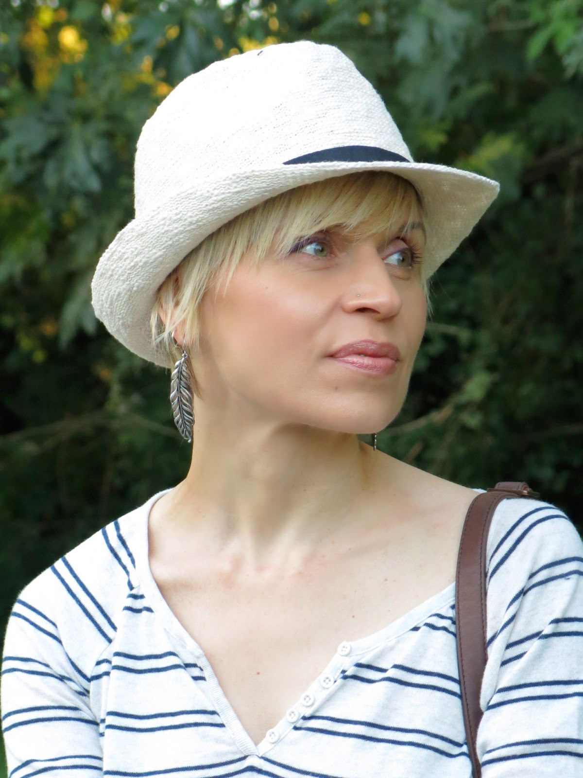 striped henley top, fedora, and accessories