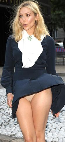 elizabeth olsen suffers wardrobe malfunction in paris see