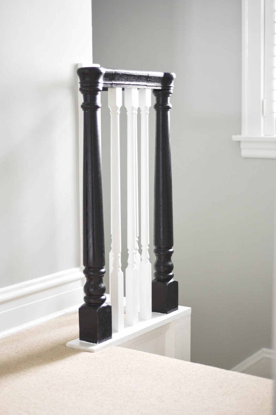 Updating older staircases, painting staircase banisters black with white spindles, #DIY #oldhomes #staircases www.homewithkeki.com