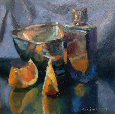 Daily painting in oils of a silver dish with blue bottle and orange segments on black marble.
