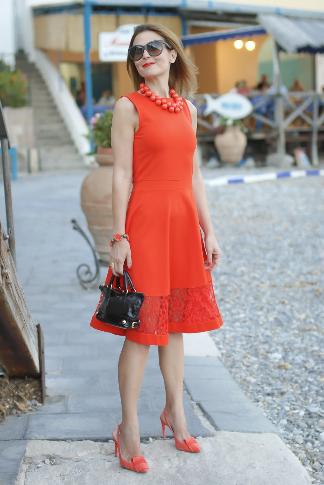 A coral midi dress from French Connection and a matchy matchy outfit on Fashion and Cookies fashion blog, fashion blogger style