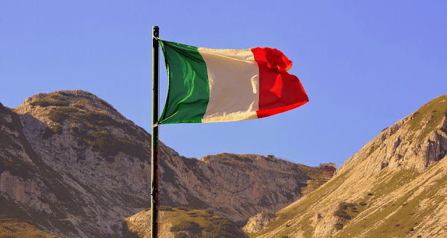 Italian flag on a mountain