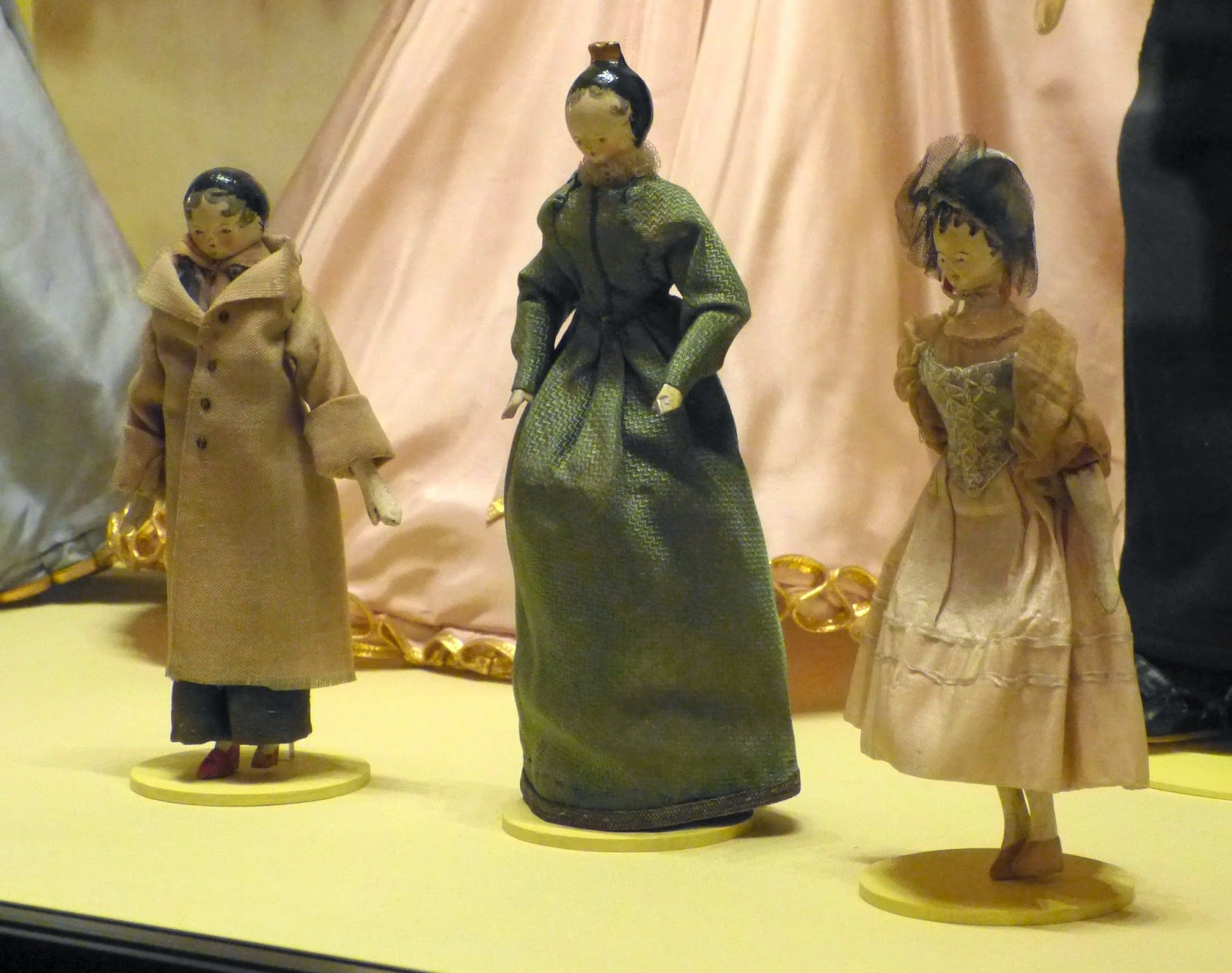 Home-made wooden dolls that belonged to the young  Queen Victoria at the Royal Childhood exhibition  at Buckingham Palace