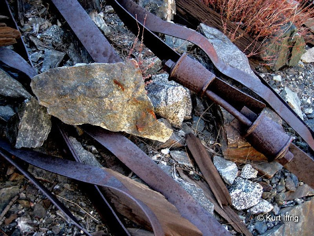 These metal straps probably secured either a structure or the loose hillside near the rock crusher.