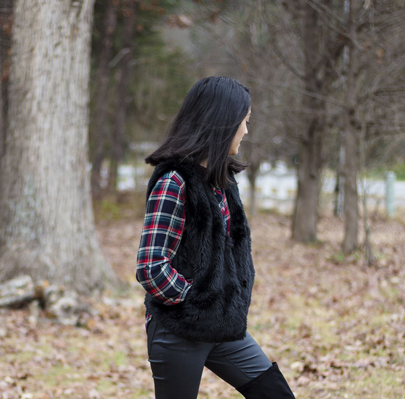 faux fur vest over plaid shirt