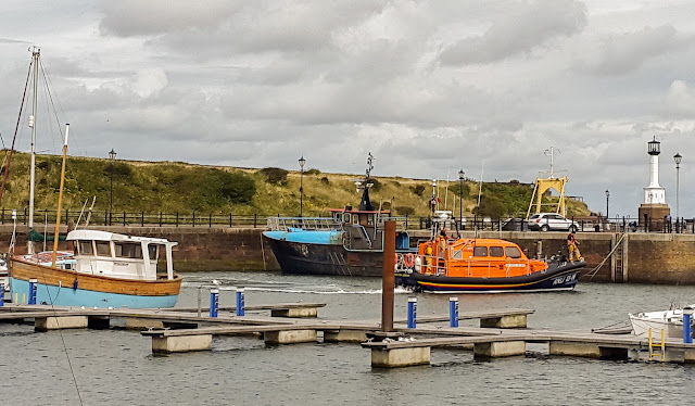 Photo of the new lifeboat leaving Maryport Marina