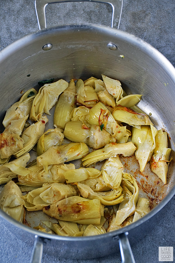 Sear artichokes until browned
