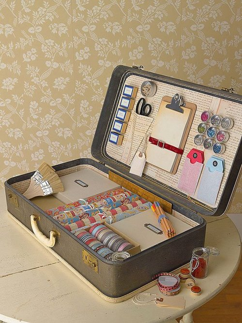 This vintage suitcase is perfect for storing art supplies like ribbon, brushes, and colored pencils.
