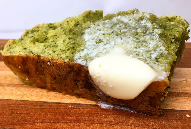 Slice of Cheddar Broccoli Quick Bread with Melting Butter