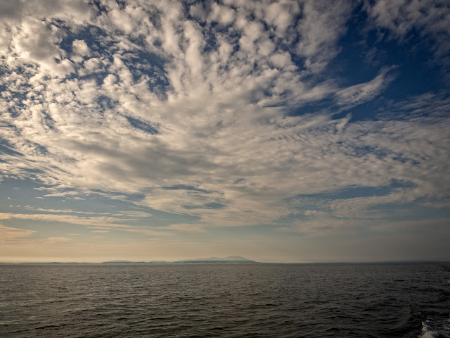 Photo of a beautiful cloud formation over the Solway Firth with Scotland in the distance