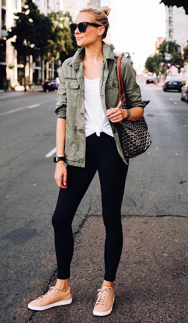 casual outfit idea with a pair of sneakers : khaki jacket + bag + white top + black leggings