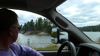 Anders driving the truck, looking at the lake side