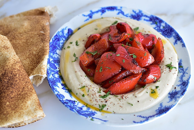 Hummus topped with Spicy Sauteed Red Pepper