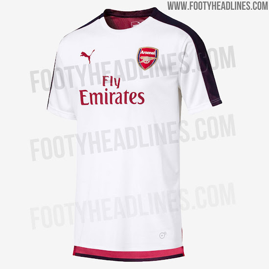 c1e6d752 A simple design with a very shiny mesh-like material, the new Arsenal  training top is red with a dark blue stripe running down the top of each  sleeve.