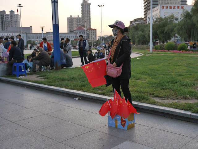 woman selling PRC flags in Mudanjiang, China