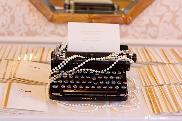 This vintage type writer adds an old Hollywood feel to the wedding's decor.
