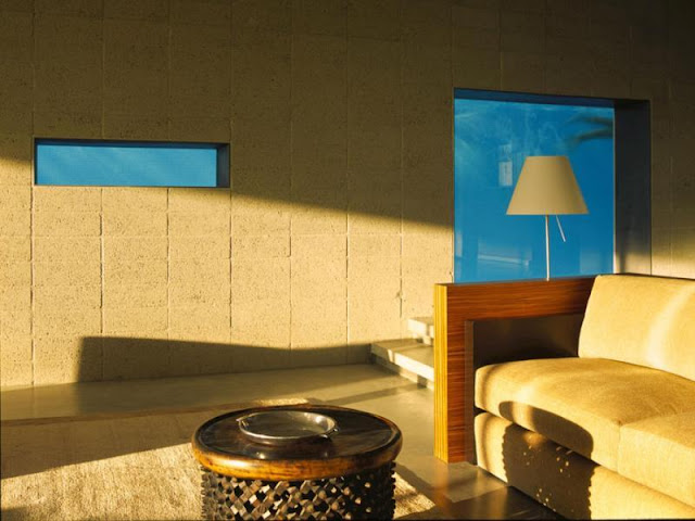 Photo of living room with windows looking into the pool