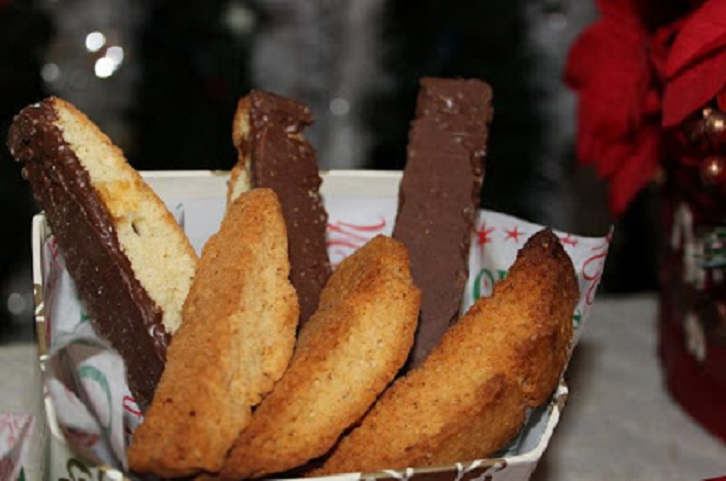 these are an anisette biscotti that are dipped in dark chocolate on the bottom of the cookies in a Christmas box