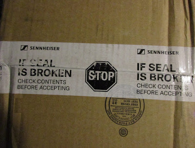 Sennheiser cardboard box warning label stop if seal is broken check contents before accepting