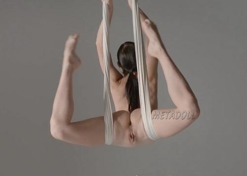 Nude air gymnastics - aerial dancer and choreographer