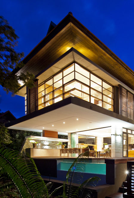 Contemporary South African SGNW House by Metropole Architects at night from the backyard