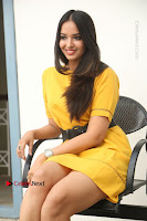Actress Poojitha Stills in Yellow Short Dress at Darshakudu Movie Teaser Launch .COM 0251.JPG