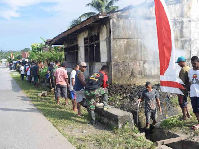 Satgas TMMD Gotong Royong Bersama Warga Yaputi