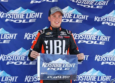 Christopher Bell, driver of the #4 JBL Toyota, poses with the Keystone  Light Pole Award