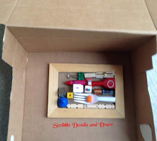 Louise Nevelson art activity for kids put frame in a box