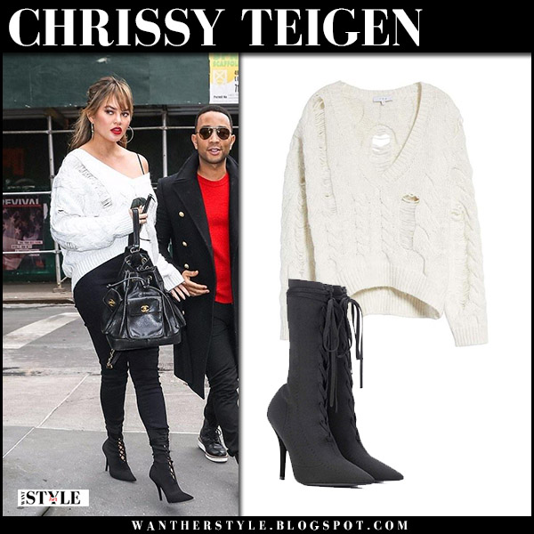 Chrissy Teigen in white knit ripped sweater iro fighla, black skinny jeans and black boots yeezy season 5 model style december 15