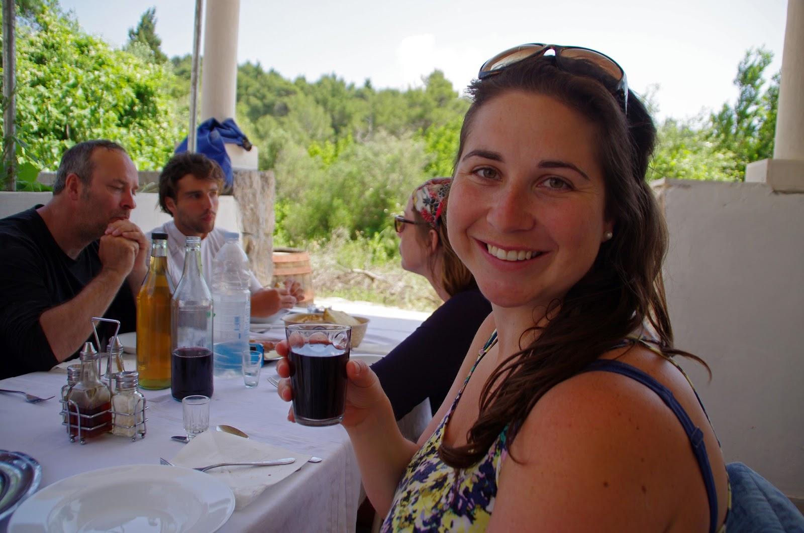 Girl drinking wine on Sipan Island