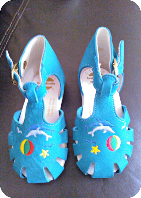 Turquoise babybotte toddler shoes with dolphins on them