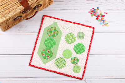 http://www.fatquartershop.com/shelling-peas-mini-quilt-downloadable-pdf-quilt-pattern