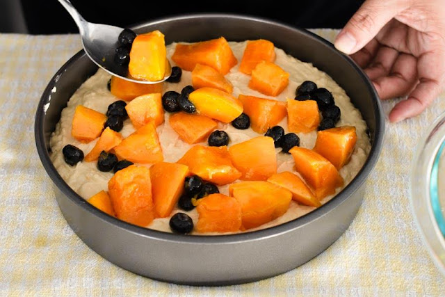 Add mango and blueberries to cake batter