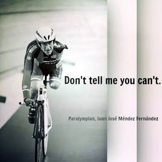Image of cyclist with one leg and one arm with the caption Don't tell me you can't