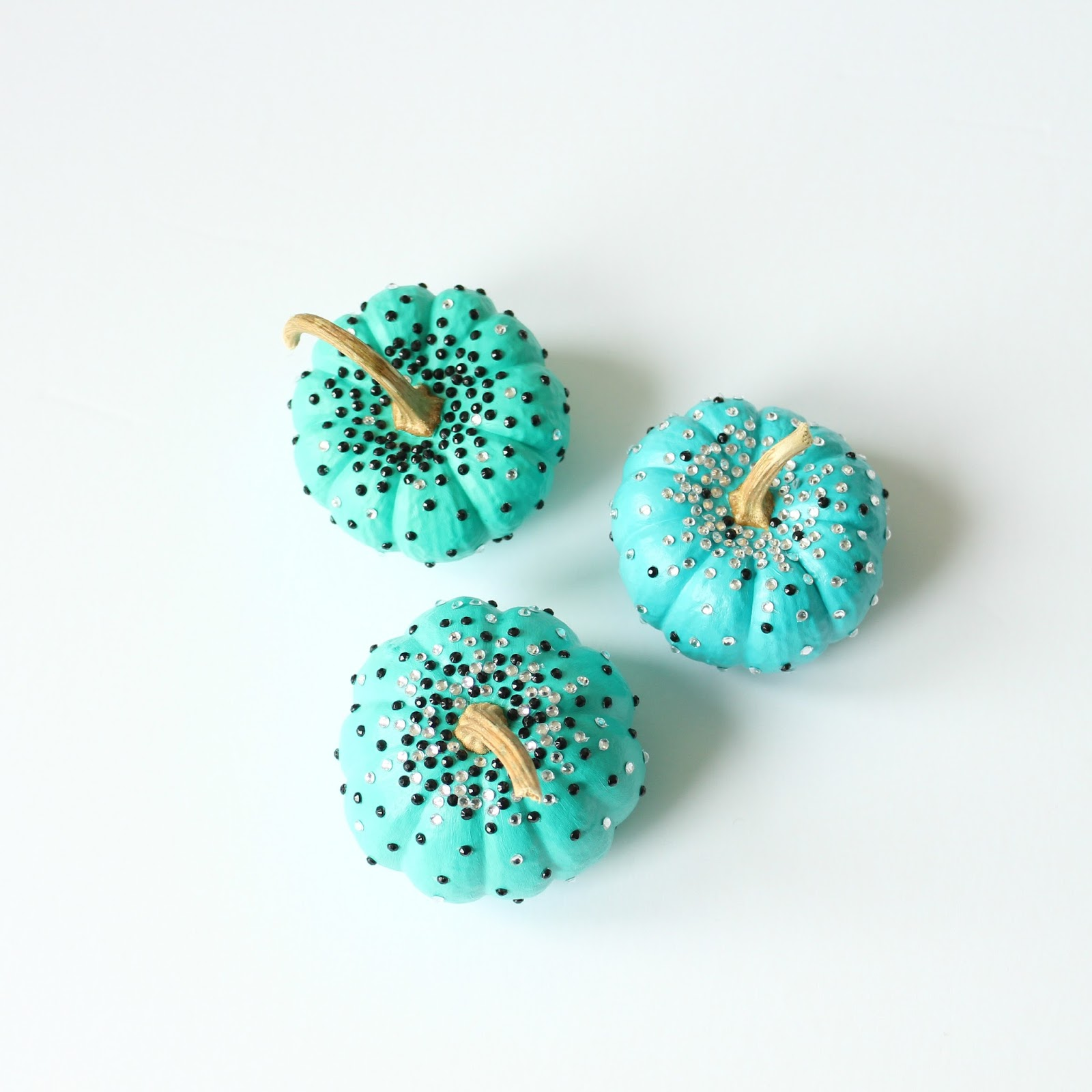 Turquoise DIY No Carve Pumpkins with Black and White Rhinestone Sparkles