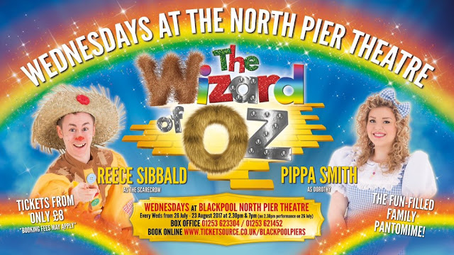 rainbow poster for panto at the pier wizard of oz