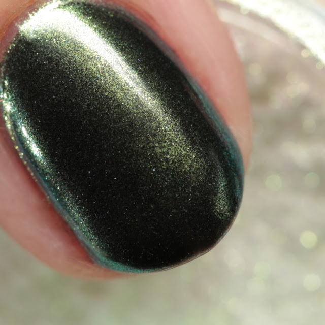 Girly Bits SFX Duo-Chrome Powder Resolution over black gel