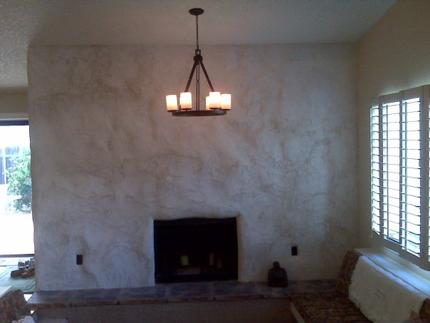 Gabrielle Paints Stucco Fireplace Wall