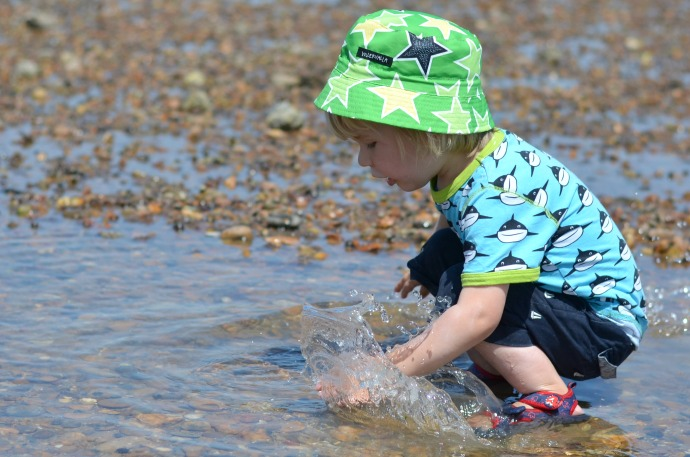 toddler at the beach, whitstable beach, pebble beach, maxomorra sharks, villervalla