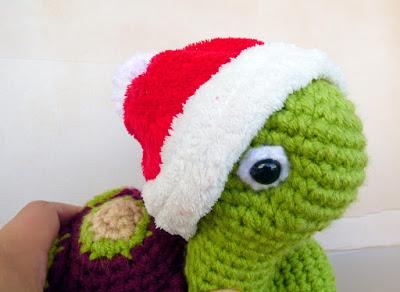 Crochet amigurumi turtle in santa hat
