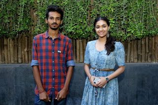 Keerthy Suresh in Blue Dress with Cute and Lovely Smile with a Fan 12