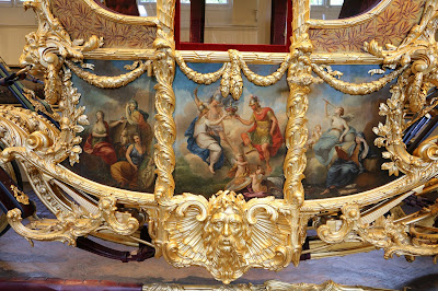 Panel detail on Gold State Coach at the Royal Mews, Buckingham Palace
