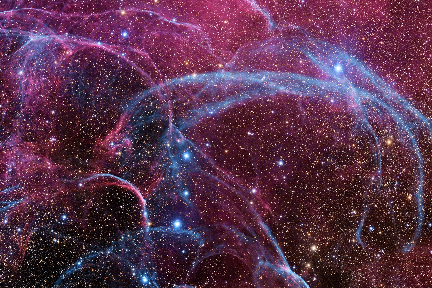 Filaments of the Vela Supernova Remnant    The explosion is over but the consequences continue. About eleven thousand years ago a star in the constellation of Vela could be seen to explode, creating a strange point of light briefly visible to humans living near the beginning of recorded history. The outer layers of the star crashed into the interstellar medium, driving a shock wave that is still visible today. A roughly spherical, expanding shock wave is visible in X-rays. This image captures some of that filamentary and gigantic shock in visible light. As gas flies away from the detonated star, it decays and reacts with the interstellar medium, producing light in many different colors and energy bands. Remaining at the center of the Vela Supernova Remnant is a pulsar, a star as dense as nuclear matter that rotates completely around more than ten times in a single second.  Image Credit & Copyright: Angus Lau, Y Van, SS Tong Explanation from: http://apod.nasa.gov/apod/ap131001.html