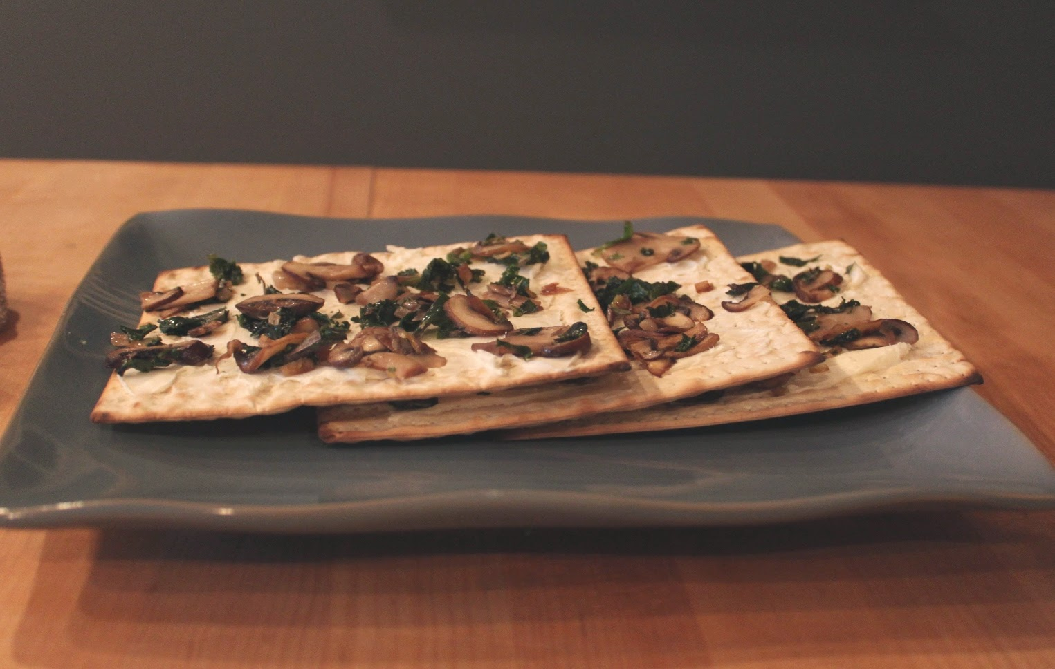 Matzah with Cream Cheese, Mushrooms and Kale | Land of Honey