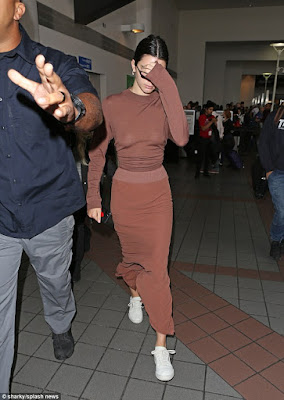 Kendall Jenner flashes her nipples as she steps out braless in a semi-sheer top