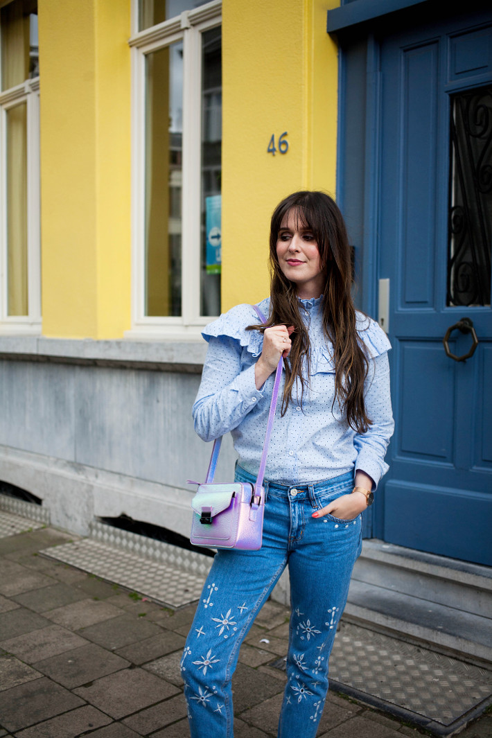 Outfit: embroidered jeans, ruffle blouse, yellow wall