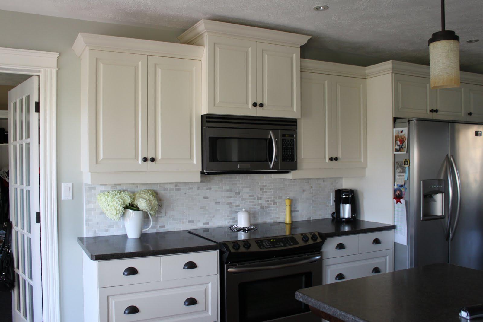 modern jane: A Glimpse Into Julie's Home. on Black Countertops With Black Backsplash  id=54059