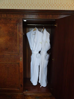 robes hanging in antique wardrobe