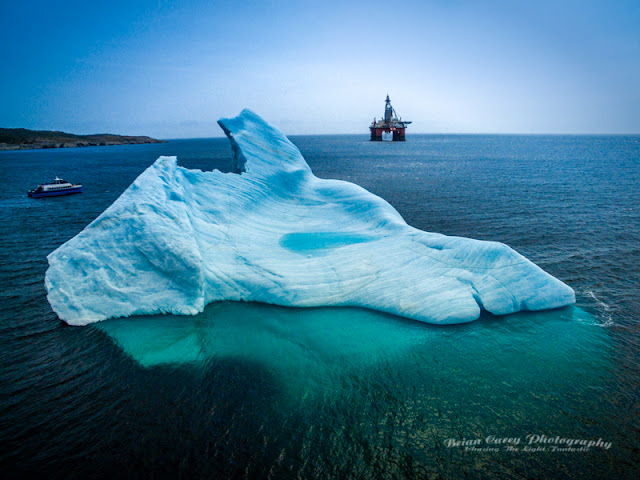 Iceberg and West Hercules Oil Rig in Bay Bulls Harbour by Brian Carey
